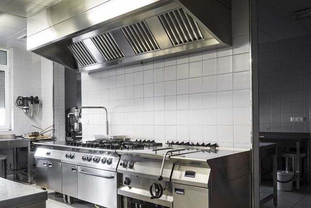 Smoke ventilation for the food industry fitted above cookers in a large kitchen