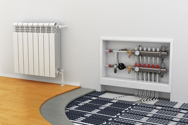 A cut-away diagram showing a radiator and underfloor heating